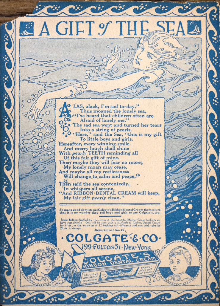 "A fully illustrated page printed in light blue ink. Title ""A Gift of The Sea"" across the top. Below, a woman floats amongst the waves of the sea, bubbles or pearls flowing from her hands. In the center a poem is printed, followed by Colgate branding and an illustration of a box of toothpaste. There is a bust portrait on either side of the box, a little girl on the left and little boy on the right, they look content."