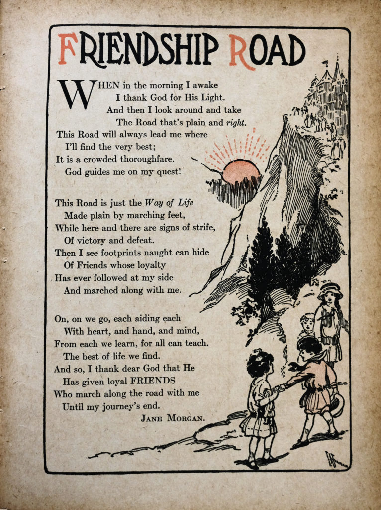 "A poem printed in mostly black ink, with accents of orange. At the top of the page is the title, ""Friendship Road"", in which the F and R are printed in orange. Below, the poem is printed. To the right of the poem is an illustration of a mountain with a castle at the top. The sun in the background is orange. There is a group of children in the foreground walking up a path towards the castle together, they are smiling and holding hands. One child is dressed in orange."